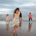 beach-family-running-playing-happy-splashing-ocean.jpg