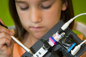 girl building with electronics