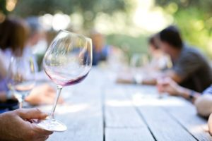 wine glass at a picnic table