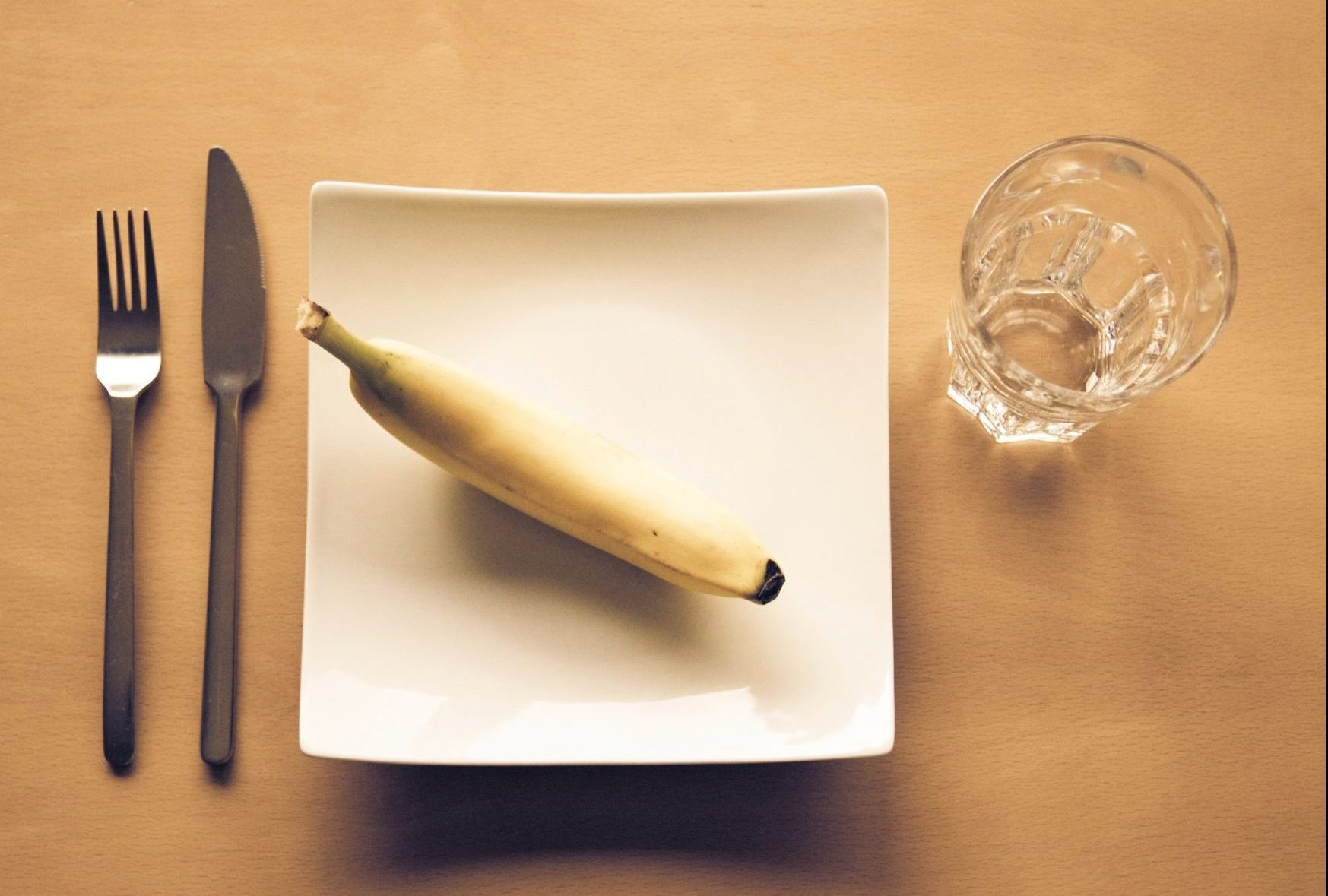 Banana on plate, diet culture